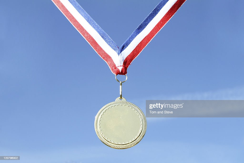 Gold medal on blue sky : Stock Photo