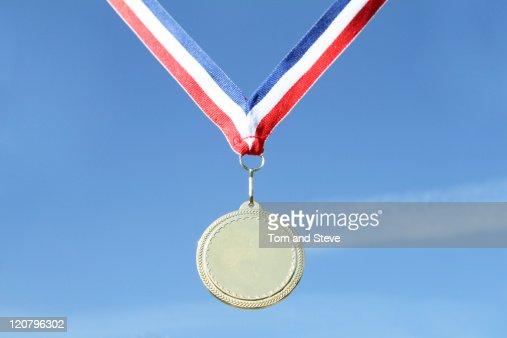 Gold medal on blue sky