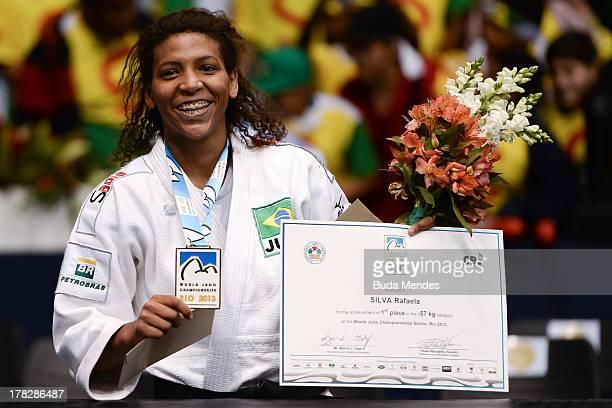 Gold medal Rafaela Silva of Brazil poses on the podium of women over 57kgs during the World Judo Championships ceremony at the Maracanazinho...