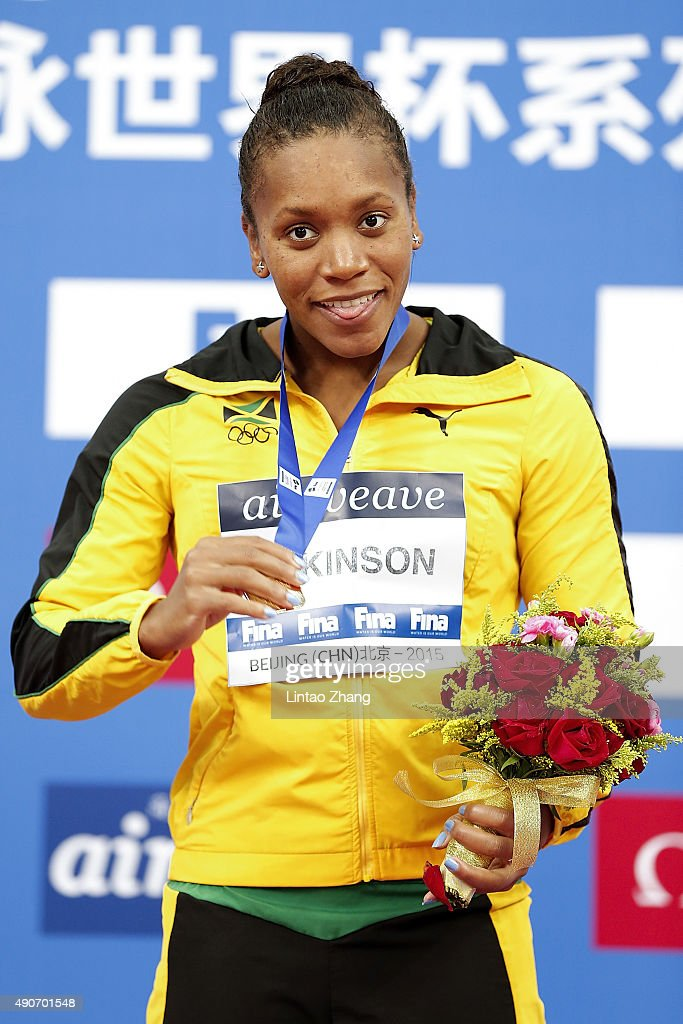 Gold medal winner <a gi-track='captionPersonalityLinkClicked' href=/galleries/search?phrase=Alia+Atkinson&family=editorial&specificpeople=881789 ng-click='$event.stopPropagation()'>Alia Atkinson</a> of Jamaica celebrate on the podium after Women's 50m Breaststroke Final at the National Aquatics Centre during day two of 2015 FINA World Cup Beijing on September 30, 2015 in Beijing, China.
