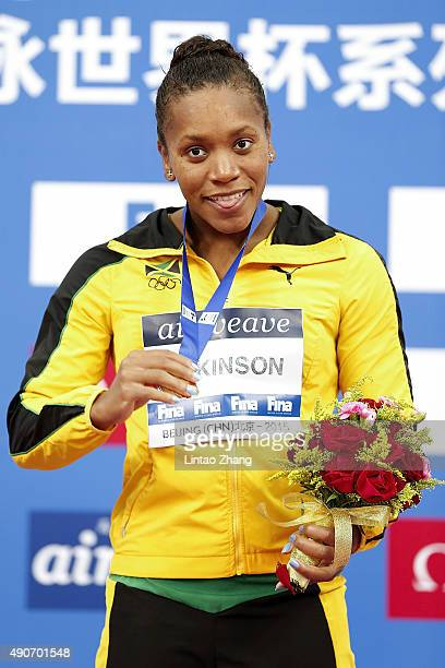 Gold medal winner Alia Atkinson of Jamaica celebrate on the podium after Women's 50m Breaststroke Final at the National Aquatics Centre during day...