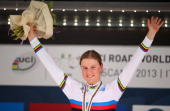 Gold medal winner and new World Champion Amalie Dideriksen of Denmark celebrates on the posdium after the Junior Women's Road Race on September 27...