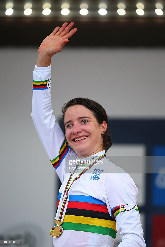 Gold medal winner and new world champion <a gi-track='captionPersonalityLinkClicked' href=/galleries/search?phrase=Marianne+Vos&family=editorial&specificpeople=779313 ng-click='$event.stopPropagation()'>Marianne Vos</a> of the Netherlands celebrates on the podium after the Elite Women's Road Race on September 28, 2013 in Florence, Italy.