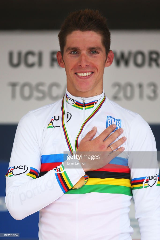 Gold medal winner and new world champion Rui Costa of Portugal celebrates on the podium after the Elite Men's Road Race, a 272km race from Lucca to Florence on September 29, 2013 in Florence, Italy.