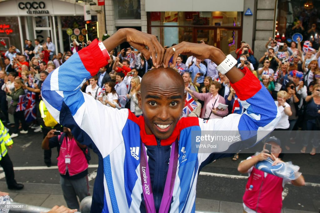 Gold Medal winner athlete <a gi-track='captionPersonalityLinkClicked' href=/galleries/search?phrase=Mo+Farah&family=editorial&specificpeople=4819130 ng-click='$event.stopPropagation()'>Mo Farah</a> performs a 'mobot' during the London 2012 Victory Parade for Team GB and Paralympic GB athletes on September 10, 2012 in London, England.