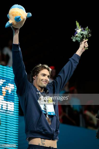 Gold medal winner Camille Lacourt of France celebrates on the podium after the Men's Backstroke 50m Final on day sixteen of the 15th FINA World...