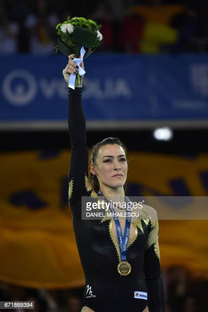 Gold medal winner Catalina Ponor of Romania poses on the podium during medals ceremony for balance beam of apparatus final for the European Artistic...