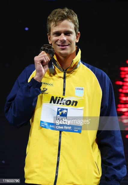 Gold medal winner Cesar Cielo Filho of Brazil celebrates on the podium after winning the Swimming Men's 50m Butterfly Final on day ten of the 15th...