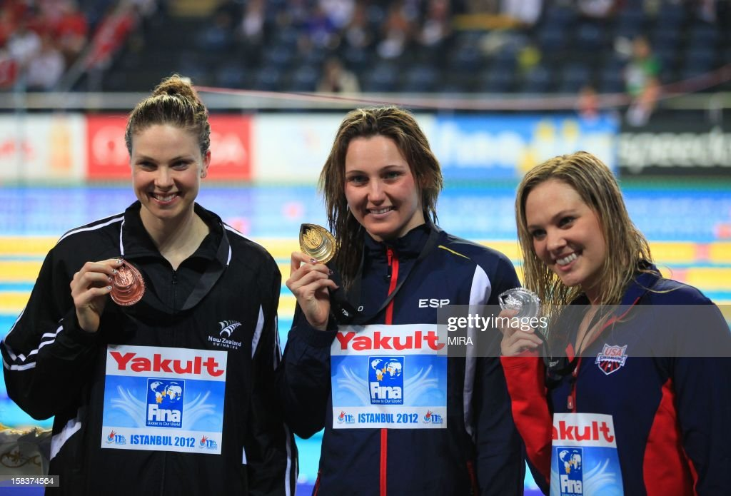 Gold medal winner Costa Schmit Melanie of Spain (C), second-placed Chloe Sutton of the US and third-placed Lauren Boyle of the New Zeland pose with their medals after the women's 400m freestyle final during the FINA World Short Course Swimming Championships in Istanbul on December 14, 2012.