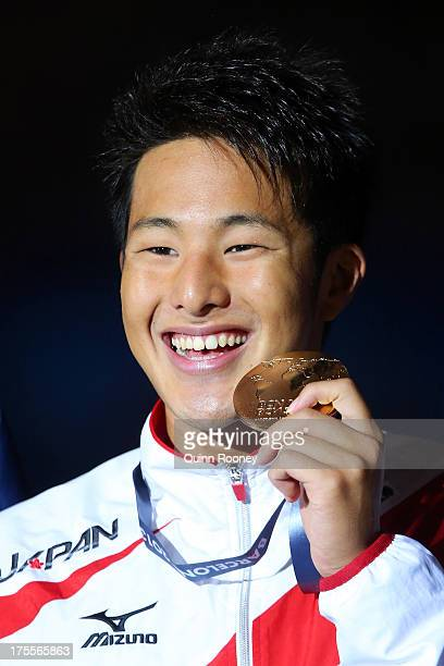 Gold medal winner Daiya Seto of Japan celebrates on the podium after the Swimming Men's Medley 400m Final on day sixteen of the 15th FINA World...