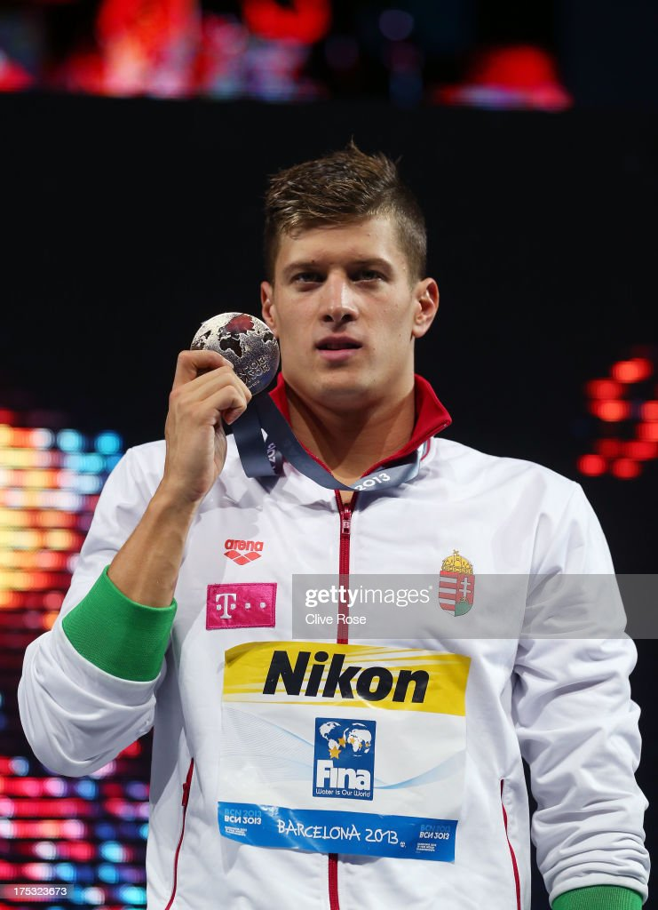 Gold medal winner <a gi-track='captionPersonalityLinkClicked' href=/galleries/search?phrase=Daniel+Gyurta&family=editorial&specificpeople=178262 ng-click='$event.stopPropagation()'>Daniel Gyurta</a> of Hungary celebrates on the podium after the Men's Breaststroke 200m Final on day fourteen of the 15th FINA World Championships at Palau Sant Jordi on August 2, 2013 in Barcelona, Spain.