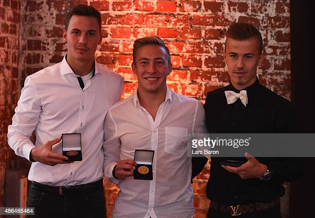 U17 gold medal winner Felix Passlack of Borussia Dortmund bronze medal winner Constantin Frommann and silver medal winner Niklas Dorsch of Bayern...
