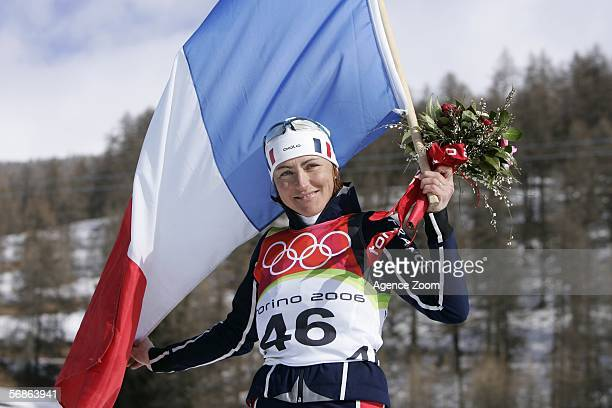 Gold Medal winner Florence BaverelRobert of France celebrates after the Womens Biathlon 75km Sprint Final on Day 6 of the 2006 Turin Winter Olympic...