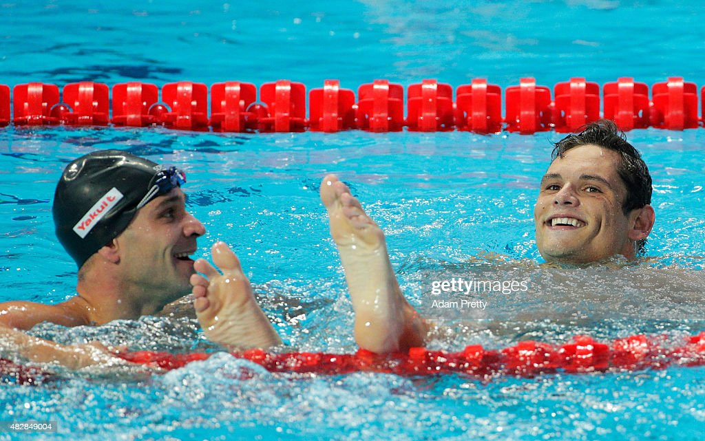 Gold medal winner Florent Manaudou of France and sliver medal winner Nicholas Santos of Brazil react after the Men's 50m Butterfly Final on day ten of the 16th FINA World Championships at the Kazan Arena on August 3, 2015 in Kazan, Russia.