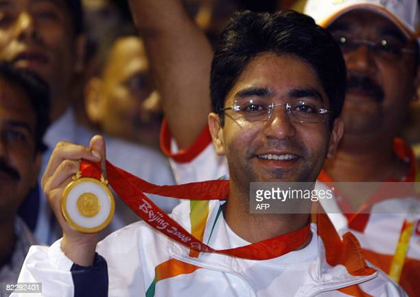 Gold medal winner for the Men's 10m Air Rifle competition at the 2008 Beijing Olympic Games Abhinav Bindra show's his medal as he arrives at the...