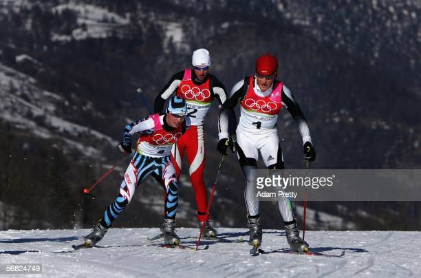 Gold Medal winner Georg Hettich of Germany competes in the Nordic Combined 15km Individual event followed by Jaakko Tallus of Finland and Felix...