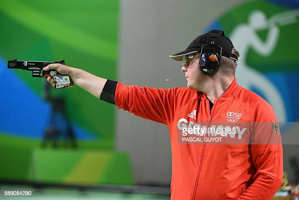 Gold medal winner Germany's Christian Reitz competes during the 25m Rapid Fire Pistol men's final at the Olympic Shooting Centre in Rio de Janeiro on...