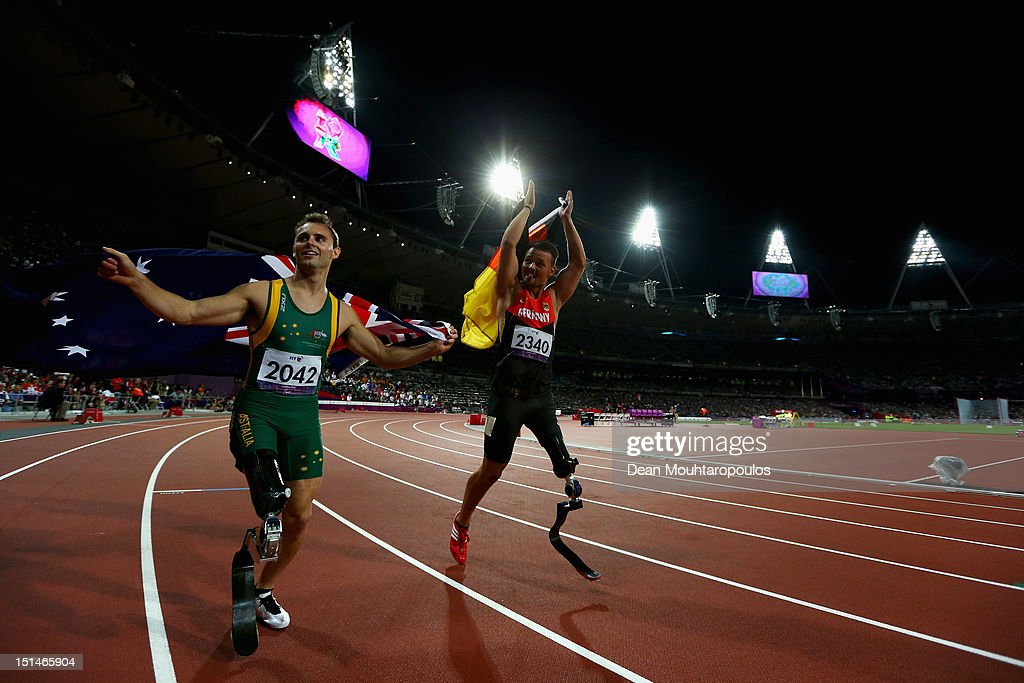 Gold medal winner, Heinrich Popow of Germany (R) and silver medallist Scott Reardon (L) of Australia celebrate after the men's 100m T42 on day 9 of the London 2012 Paralympic Games at Olympic Stadium on September 7, 2012 in London, England.