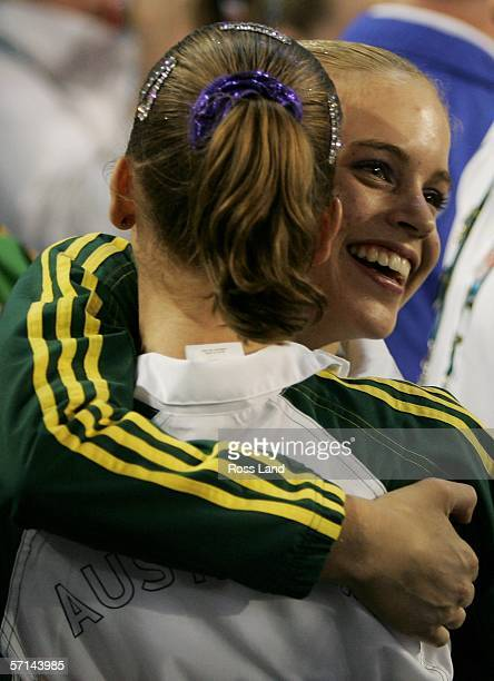 Gold medal winner Hollie Dykes of Australia hugs Ashleigh Brennan of Australia who won silver after the Women's Floor Final in the artistic...