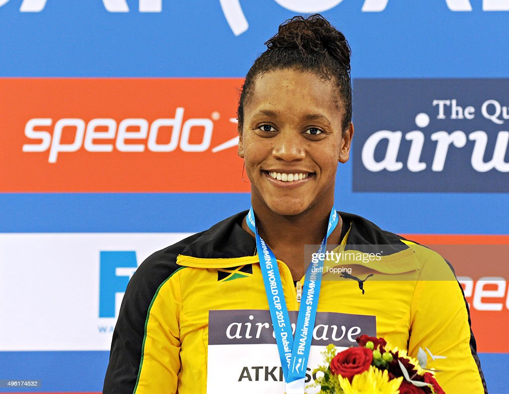 Gold medal winner in the women's 50 meter Breaststroke, <a gi-track='captionPersonalityLinkClicked' href=/galleries/search?phrase=Alia+Atkinson&family=editorial&specificpeople=881789 ng-click='$event.stopPropagation()'>Alia Atkinson</a>, of Jamaica, on the awards podium at the FINA Swimming World Cup 2015 at the Hamdan Sports Complex November 7, 2015 in Dubai, United Arab Emirates.