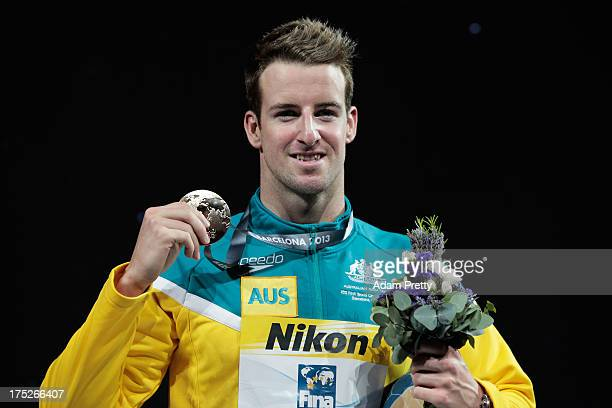 Gold medal winner James Magnussen of Australia celebrates on the podium the Swimming Men's Freestyle 100m Final on day thirteen of the 15th FINA...