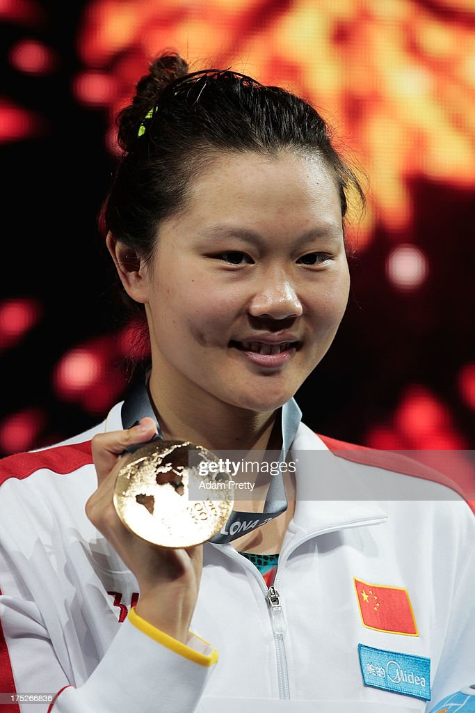 Gold medal winner Jing Zhao of China celebrates on the podium after the Swimming Women's Backstroke 50m Final on day thirteen of the 15th FINA World Championships at Palau Sant Jordi on August 1, 2013 in Barcelona, Spain.