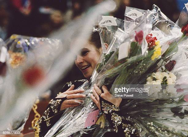 Gold medal winner Katarina Witt of East Germany celebrates on the podium during the 1987 World Figure Skating Championships 14 March 1987 in...