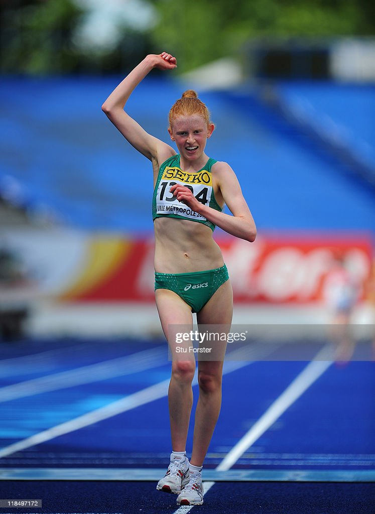 Gold medal winner Kate Veale of Ireland celebrates after winning the Girls 5000 metres race walk during day three of the IAAF World Youth Championships at Lille Metropole stadium on July 8, 2011 in Lille, France.