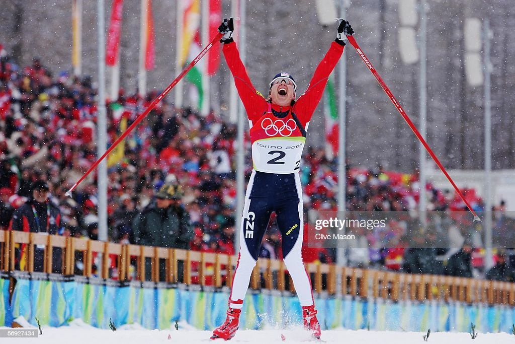 Gold Medal winner Katerina Neumannova of the Czech Republic celebrates as she crosses the finish line in the Womens Cross Country Skiing 30km Mass...