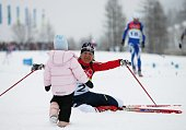Gold medal winner Katerina Neumannova of the Czech Republic celebrates with her daughter Lucie in the Womens Cross Country Skiing 30km Mass Start...