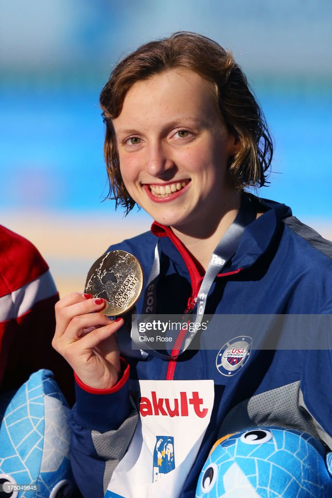 Gold medal winner <a gi-track='captionPersonalityLinkClicked' href=/galleries/search?phrase=Katie+Ledecky&family=editorial&specificpeople=9595921 ng-click='$event.stopPropagation()'>Katie Ledecky</a> of the USA celebrates on the podium after setting a new World Record time of 15:36.53 in the Swimming Women's 1500m Freestyle Final on day eleven of the 15th FINA World Championships at Palau Sant Jordi on July 30, 2013 in Barcelona, Spain.
