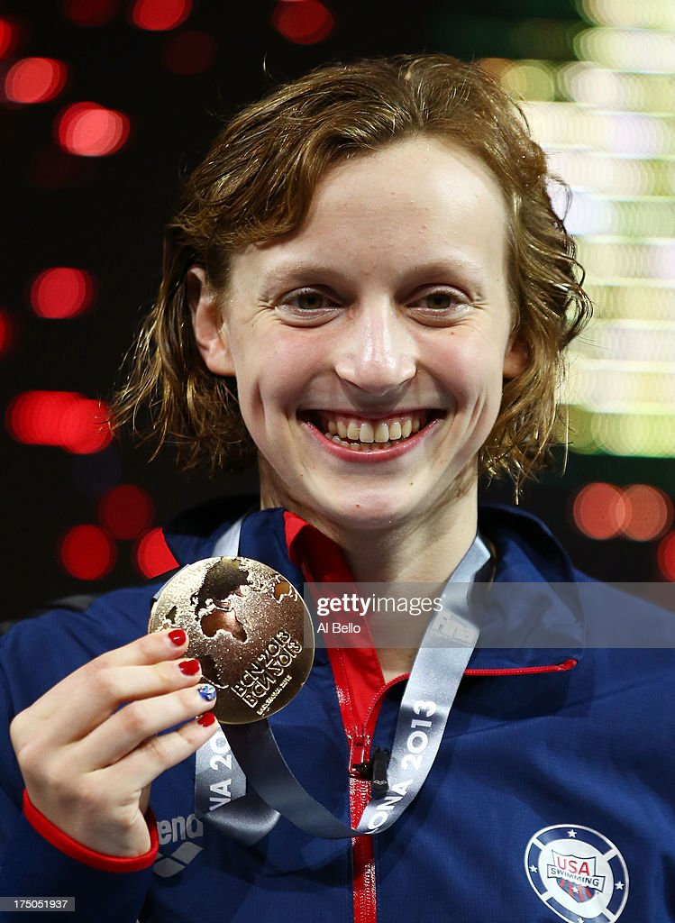 Gold medal winner Katie Ledecky of the USA celebrates on the podium after setting a new World Record time of 15:36.53 in the Swimming Women's 1500m Freestyle Final on day eleven of the 15th FINA World Championships at Palau Sant Jordi on July 30, 2013 in Barcelona, Spain.
