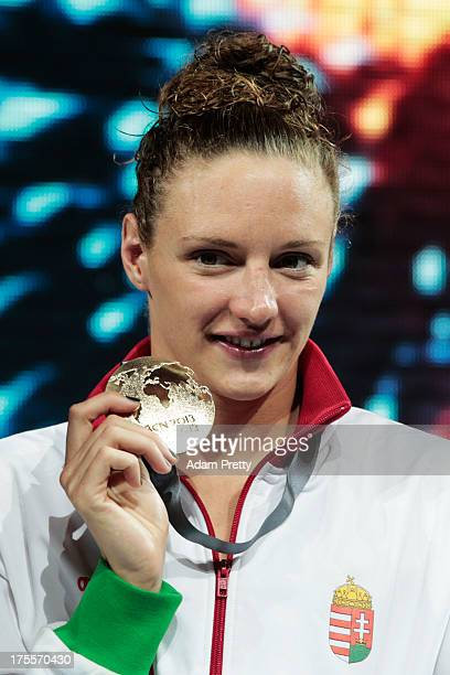 Gold medal winner Katinka Hosszu of Hungary celebrates on the podium after the Swimming Women's Individual Medley 400m Final on day sixteen of the...
