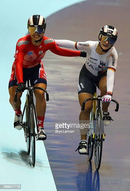 Gold medal winner Kristina Vogel of Germany celebrates alongside silver medal winner Wai Sze Lee of Hong Kong after the Women's Sprint Final on day...