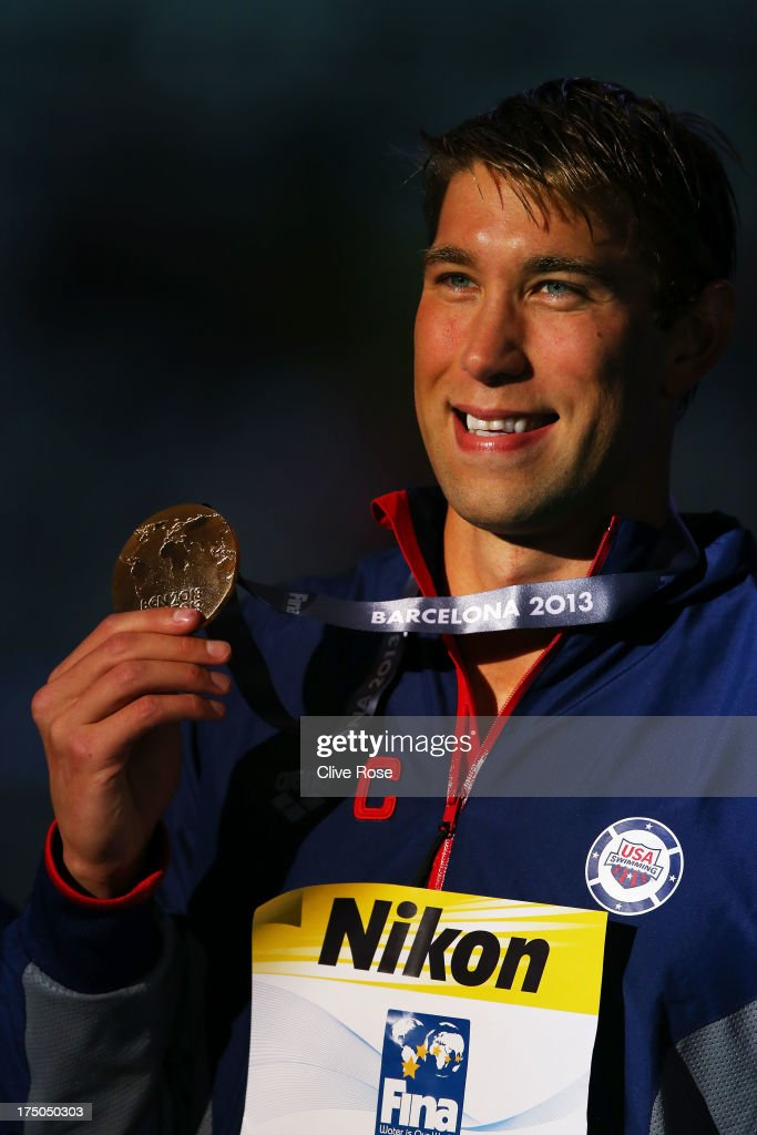 Gold medal winner Matt Greevers of the USA celebrates on the podium after the Swimming Men's 100m Backstroke Final on day eleven of the 15th FINA World Championships at Palau Sant Jordi on July 30, 2013 in Barcelona, Spain.