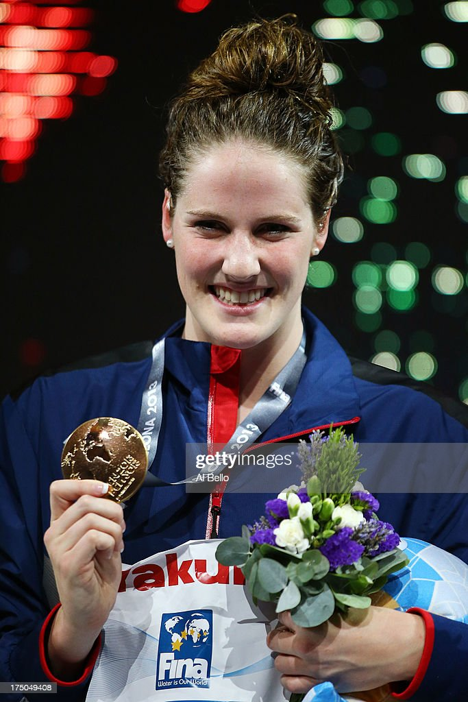 Gold medal winner <a gi-track='captionPersonalityLinkClicked' href=/galleries/search?phrase=Missy+Franklin+-+Swimmer&family=editorial&specificpeople=6623958 ng-click='$event.stopPropagation()'>Missy Franklin</a> of the USA celebrates on the podium after winning the Swimming Women's 100m Backstroke Final on day eleven of the 15th FINA World Championships at Palau Sant Jordi on July 30, 2013 in Barcelona, Spain.
