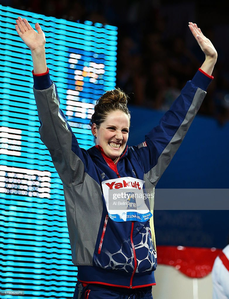 Gold medal winner Missy Franklin of the USA celebrates on the podium after winning the Swimming Women's 100m Backstroke Final on day eleven of the 15th FINA World Championships at Palau Sant Jordi on July 30, 2013 in Barcelona, Spain.