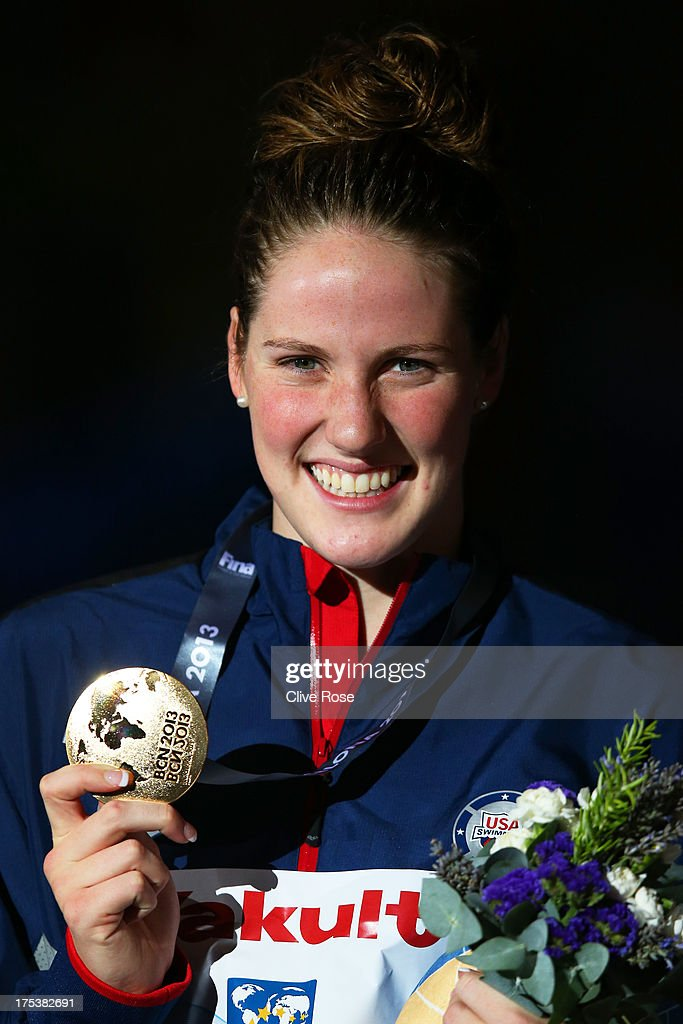 Gold medal winner <a gi-track='captionPersonalityLinkClicked' href=/galleries/search?phrase=Missy+Franklin&family=editorial&specificpeople=6623958 ng-click='$event.stopPropagation()'>Missy Franklin</a> of the USA celebrates on the podium after the Swimming Women's Backstroke 200m Final on day fifteen of the 15th FINA World Championships at Palau Sant Jordi on August 3, 2013 in Barcelona, Spain.