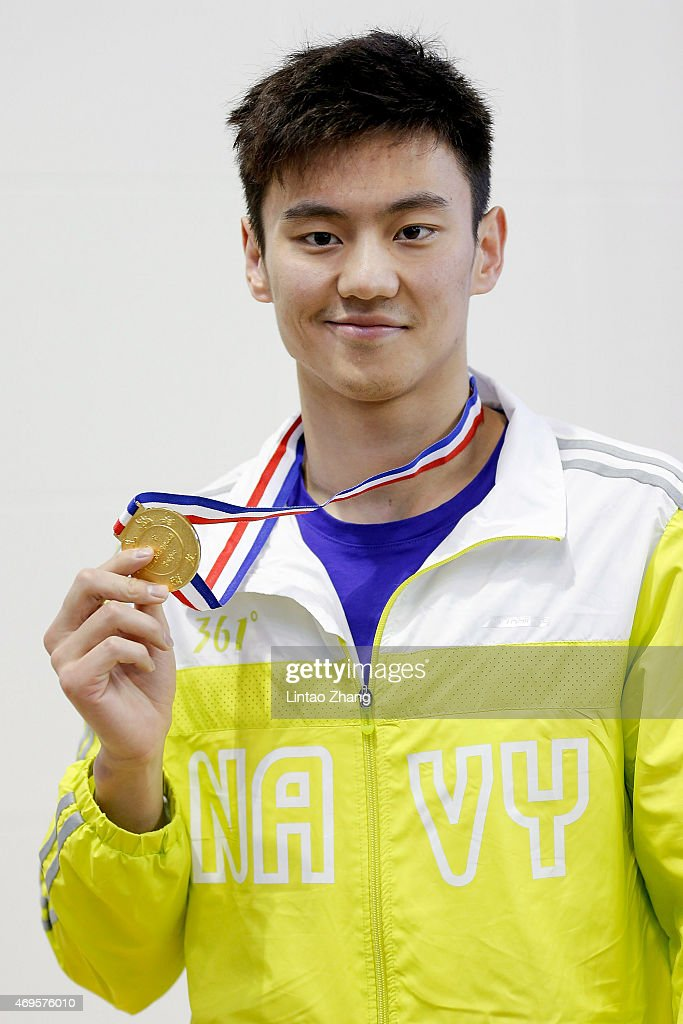 Gold medal winner Ni Zetao of China celebrates on the podium after the Men's 100 meters freestyle final on day five of the China National Swimming Championships on April 13, 2015 in Baoji, Shanxi Province, China.