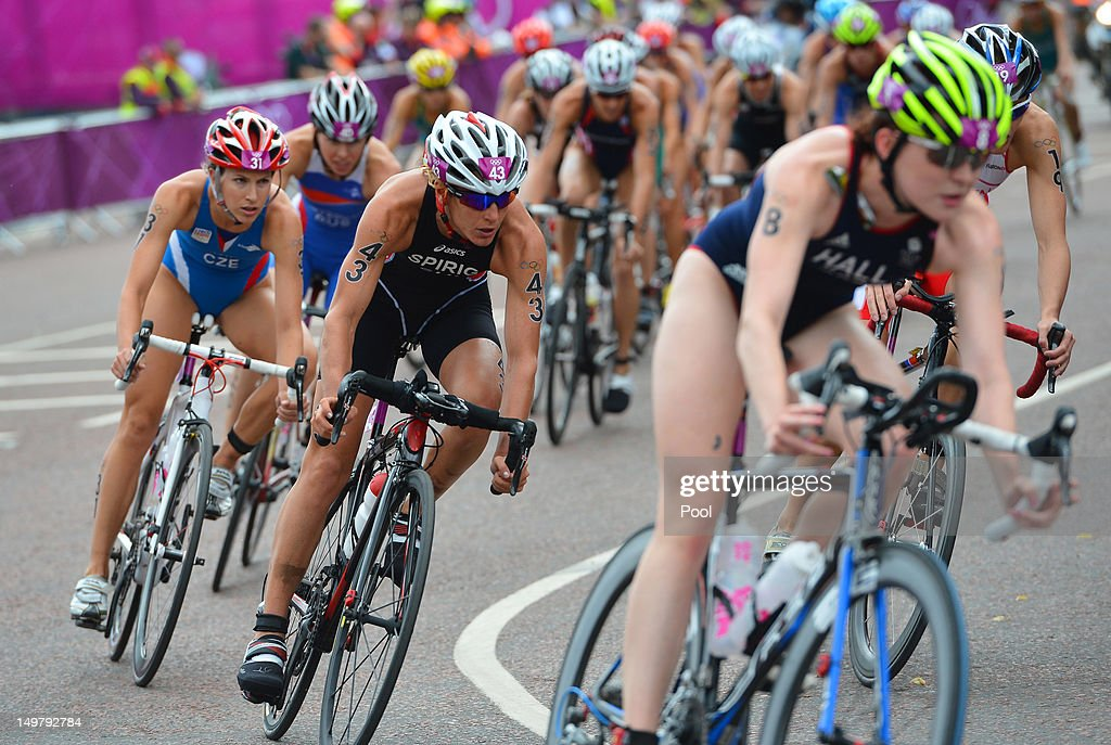 Gold medal winner Nicola Spirig of Switzerland (C) competes in the Women's Triathlon on Day 8 of the London 2012 Olympic Games at Hyde Park on August 4, 2012 in London, England.