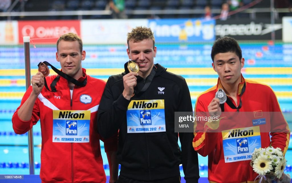 Gold medal winner Paul Bierdermann of Germany, second-placed Yun Hao of China (R) and third-placed Mads Glaesner (L) pose with their medals after winning the men's 400m Freestyle final during the FINA World Short Course Swimming Championships in Istanbul on December 14, 2012.