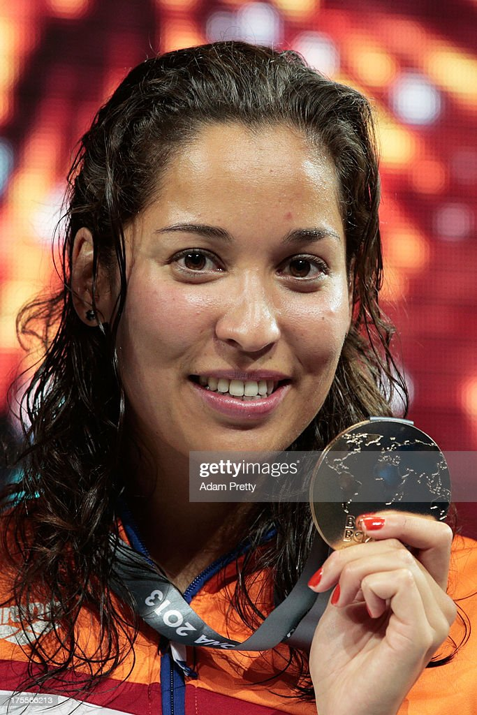 Gold medal winner <a gi-track='captionPersonalityLinkClicked' href=/galleries/search?phrase=Ranomi+Kromowidjojo&family=editorial&specificpeople=4209840 ng-click='$event.stopPropagation()'>Ranomi Kromowidjojo</a> of the Netherlands celebrates on the podium after the Swimming Women's Freestyle 50m Final on day sixteen of the 15th FINA World Championships at Palau Sant Jordi on August 4, 2013 in Barcelona, Spain.