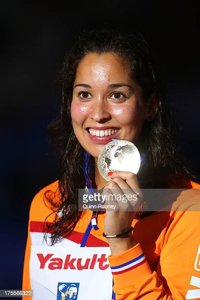 Gold medal winner Ranomi Kromowidjojo of the Netherlands celebrates on the podium after the Swimming Women's Freestyle 50m Final on day sixteen of...