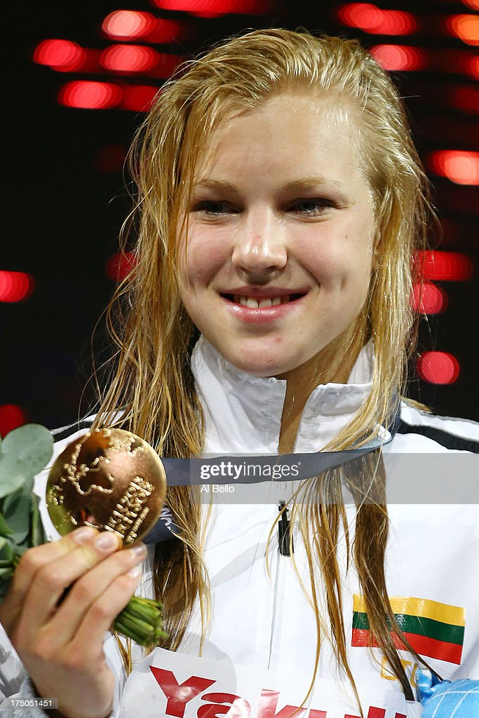 Gold medal winner <a gi-track='captionPersonalityLinkClicked' href=/galleries/search?phrase=Ruta+Meilutyte&family=editorial&specificpeople=7539009 ng-click='$event.stopPropagation()'>Ruta Meilutyte</a> of Lithuania celebrates on the podium after the Swimming Women's 100m Breastroke Final on day eleven of the 15th FINA World Championships at Palau Sant Jordi on July 30, 2013 in Barcelona, Spain.
