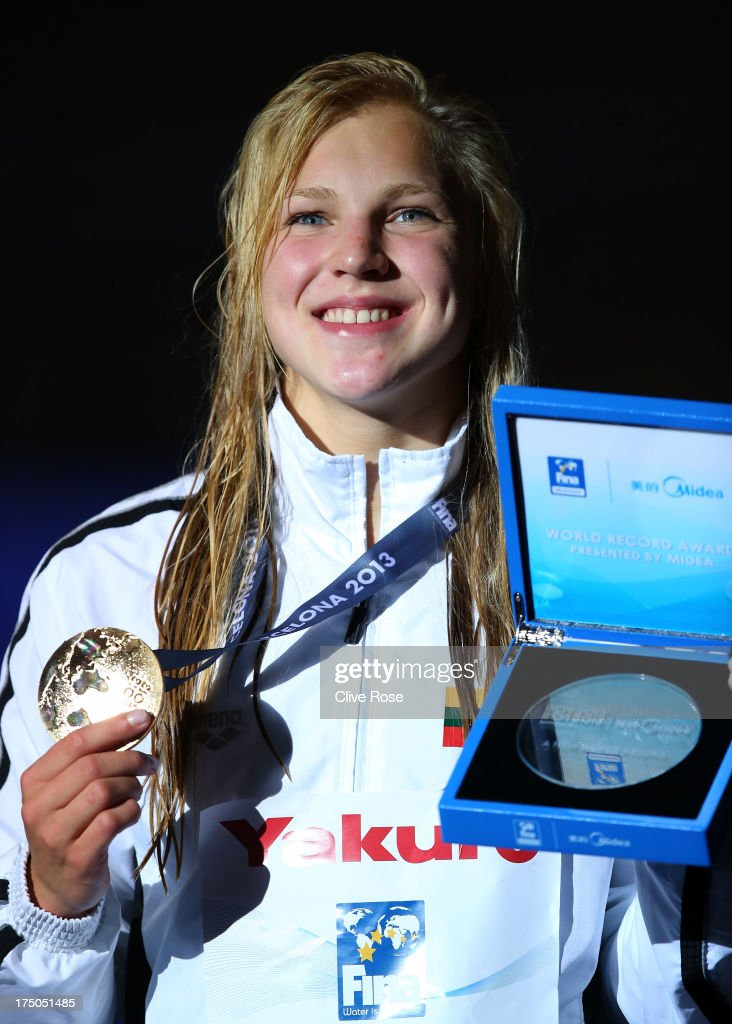 Gold medal winner Ruta Meilutyte of Lithuania celebrates on the podium after the Swimming Women's 100m Breastroke Final on day eleven of the 15th FINA World Championships at Palau Sant Jordi on July 30, 2013 in Barcelona, Spain.