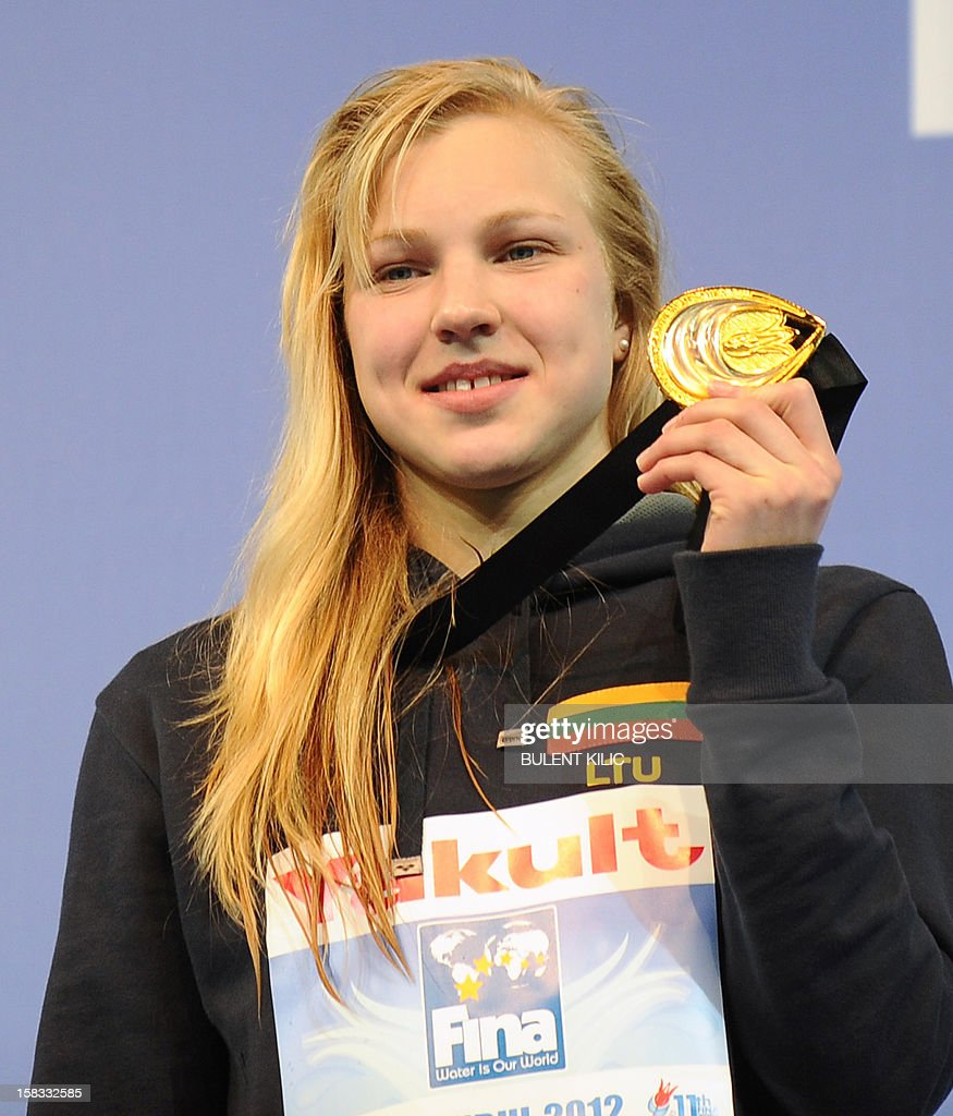 Gold medal winner Ruta Meilutyte of Lithuania poses after winning the women`s 50m breasttroke on December 13, 2012 of the FINA World Short Course Swimming Championships in Istanbul.