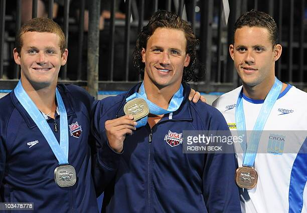 Gold medal winner Ryan Lochte of the US silver medal winnre Tyler Clary of the US and bronze medal winner Thiago Pereira of Brazil pose on the podium...