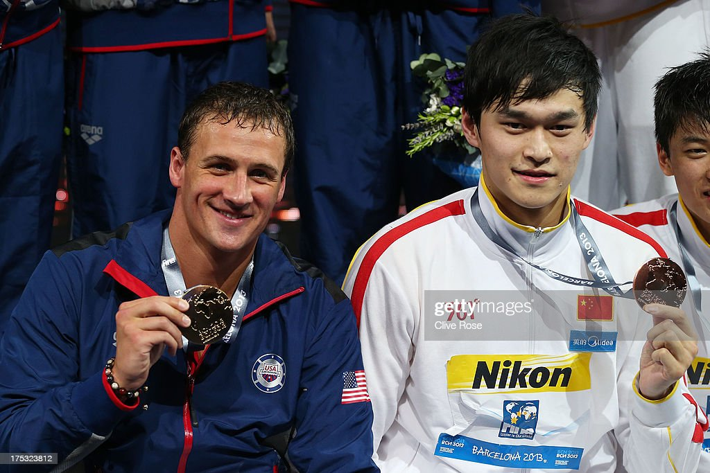 Gold medal winner <a gi-track='captionPersonalityLinkClicked' href=/galleries/search?phrase=Ryan+Lochte&family=editorial&specificpeople=182557 ng-click='$event.stopPropagation()'>Ryan Lochte</a> (L) of the USA and Bronze medal winner Yang Sun of China celebrate on the podium after the Men's Freestyle 4x200m Final on day fourteen of the 15th FINA World Championships at Palau Sant Jordi on August 2, 2013 in Barcelona, Spain.
