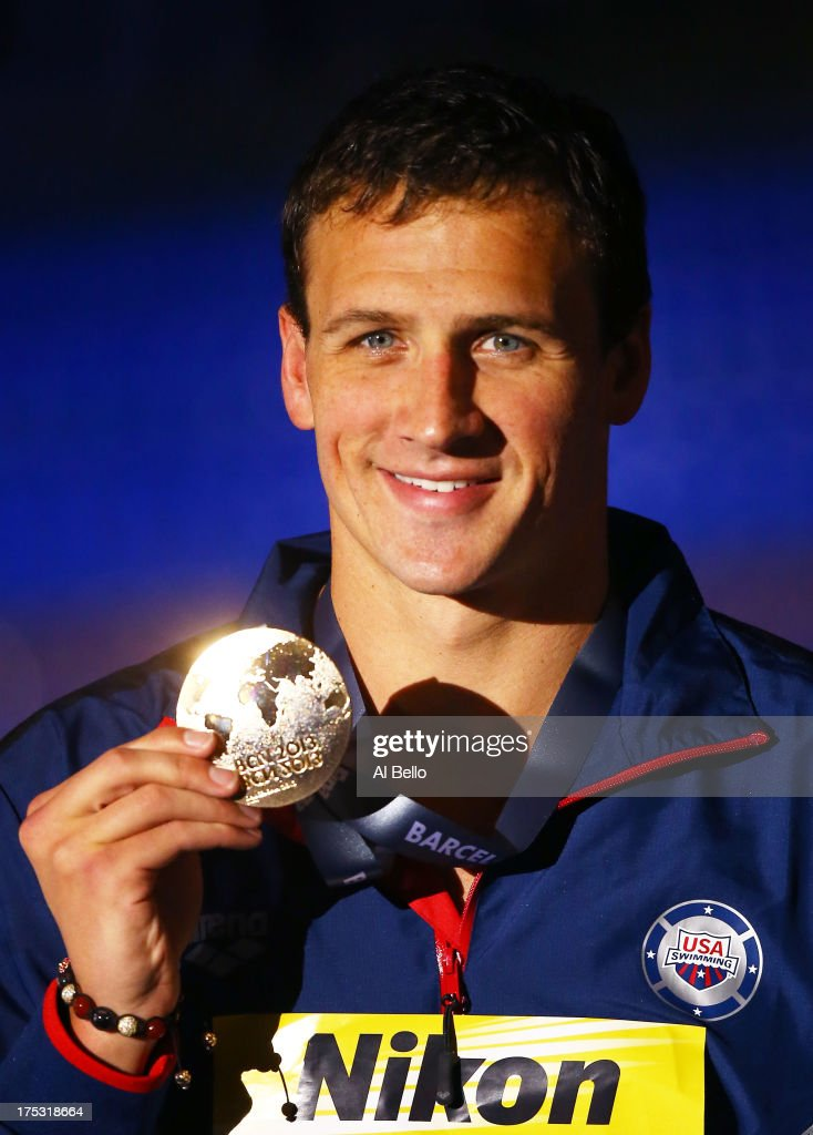 Gold medal winner <a gi-track='captionPersonalityLinkClicked' href=/galleries/search?phrase=Ryan+Lochte&family=editorial&specificpeople=182557 ng-click='$event.stopPropagation()'>Ryan Lochte</a> of the USA celebrates on the podium after the Swimming Men's Backstroke 200m Final on day fourteen of the 15th FINA World Championships at Palau Sant Jordi on August 2, 2013 in Barcelona, Spain.