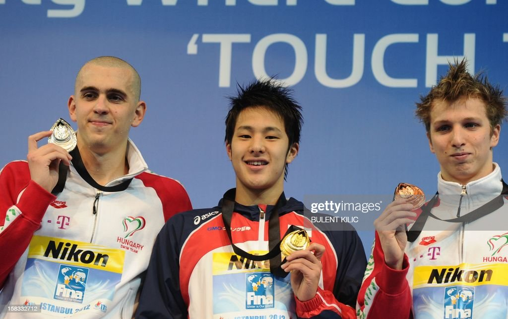 Gold medal winner Seto Daiya of Japan (C), silver medal winner Laszlo Cseh (L) of Hungary and bronze medal winner David Verraszto of Hungary pose after the men`s 400m individual medley on December 13, 2012 of the FINA World Short Course Swimming Championships in Istanbul. AFP PHOTO/BULENT KILIC
